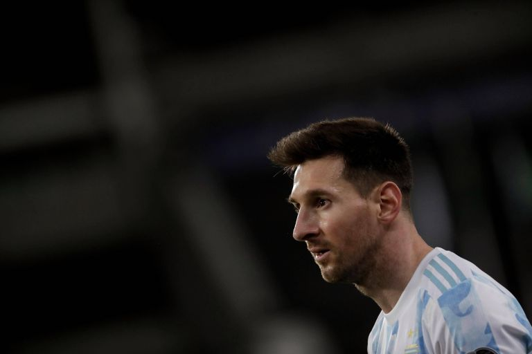 Lionel Messi lifts the Copa America trophy for the first time in his storied career